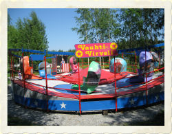 TILT-A-WHIRL - Height restriction: must be at least 120cm (47') to ride, 100-120cm (39-47') with adult